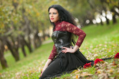 Gothic girl in the autumn park Royalty Free Stock Photos