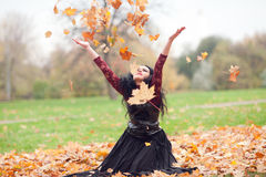 Gothic girl in the autumn park Stock Photos