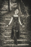 Gothic girl. Beautiful Gothic girl in woods stock image