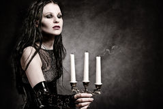 Gothic girl with candles. Gothic girl in fetish clothes with candles Stock Photo