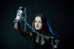 Gothic girl with chains Stock Images
