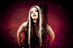 Gothic girl in corset clothes royalty free stock photography