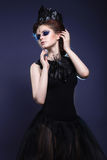 Gothic girl with a crown and a necklace of feather Stock Photos