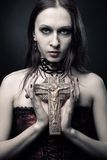 Gothic girl with crucifix Royalty Free Stock Image