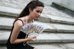 Gothic girl with a fan Stock Photography