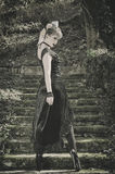 Gothic girl fashion. Beautiful fashion Gothic girl on stairs royalty free stock photos