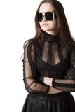 Gothic girl in glasses. Posing over white background Stock Images