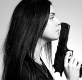 Gothic girl with gun Stock Image