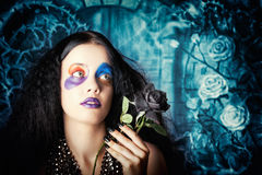 Gothic girl holding black rose. Death and mourning Royalty Free Stock Photos