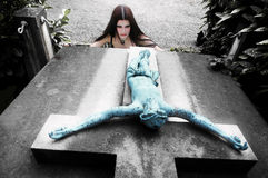 Gothic girl on inverted cross Royalty Free Stock Photos