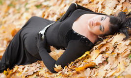 Gothic girl in the leaves Stock Photography