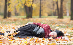 Gothic girl in the leaves Stock Image