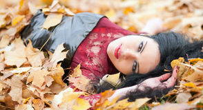 Gothic girl in the leaves Stock Images