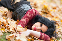 Gothic girl in the leaves royalty free stock photography