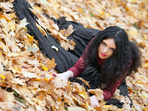 Gothic girl in the leaves Stock Photo