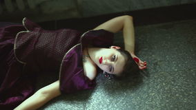 Gothic girl lying on the floor with his eyes open. It gothic dress stock video footage