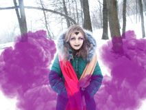 Gothic girl model in winter in dark lenses. And with false purple eyelashes stock images