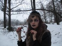Gothic girl model in winter in dark lenses. And with false purple eyelashes stock photo
