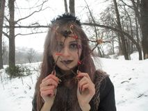 Gothic girl model in winter in dark lenses. And with false purple eyelashes royalty free stock photos