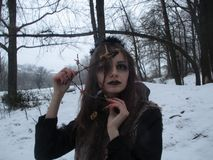 Gothic girl model in winter in dark lenses. And with false purple eyelashes stock photography