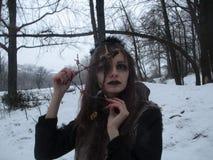 Gothic girl model in winter in dark lenses stock photography