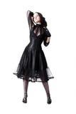 Gothic girl posing over white background. Gothic girl in black dress posing over white background Royalty Free Stock Photos