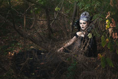 Gothic girl sleeping in the woods. Gothic girl in black clothes is sleeping in the woods royalty free stock image