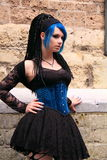 Gothic girl street fashion. Beautiful gothic girl wearing black dress and blue corset during the gothic festival summer darkness in the dutch city utrecht, the Royalty Free Stock Images