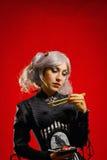 Gothic girl with sushi Royalty Free Stock Image