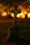 Gothic gravestone. With a cross by night stock photos
