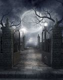 Gothic graveyard 3. Gothic cemetery gate with a lantern and dead trees royalty free illustration