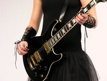 Gothic guitar player, female. Female dressed in black Gothic, playing an electric guitar. Isolated on white Stock Photography