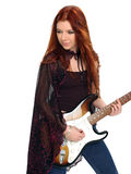 Gothic Guitarist. Beautiful Gothic redhead jamming on an electric guitar. Isolated over white royalty free stock photo