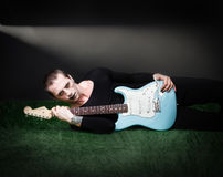 Gothic guitarist lying down Stock Photography