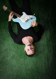 Gothic guitarist lying down Royalty Free Stock Images