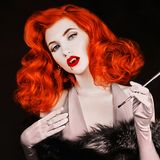 Gothic halloween attire. Vampire with open mouth and fangs. Victorian woman with pale skin on black background. Gothic redhead mod. El with blood on lips. Outfit stock photos