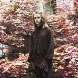 Gothic halloween clothes. Gloomy earl. Prince with hairstyle. Punk with long hair. Vampire man with hairdo. Gloomy outfit for hall royalty free stock photography