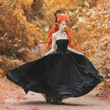 Gothic halloween gown. Young medieval fantastic queen with hairstyle. Lady with red hair. Vampire with pale skin. Medieval outfit stock image