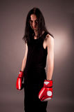 Gothic handsome man with boxing gloves Royalty Free Stock Photos