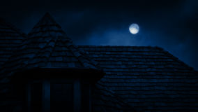 Gothic House Roof With Full Moon. Gothic rooftop of old house at night with full moon above stock footage