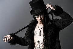 Gothic image. Gothic man in black coat and top-hat over gray background stock photography