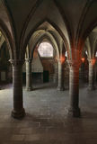 Gothic indoors architecture. Gothic columns and arches inside the monastry from Mount St Michel,France Royalty Free Stock Photography