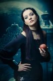 Gothic lady. With an apple in his hand Royalty Free Stock Photos