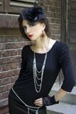 Modern gothic style. Beautiful girl in a gothic inspired outfit royalty free stock photo