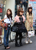 Gothic lolitas. Three gothic lolitas are standing aimlessly in the street in Shibuya, Tokyo, Japan. Image illustrates japanese subcultures and youth culture royalty free stock photo