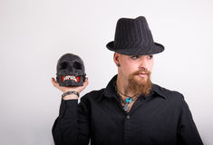 Gothic man with skull Royalty Free Stock Photo