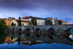 Gothic medieval stony bridge on Otava river. Oldest bridge historical town Pisek, South Bohemia, Czech republic, Europe. Beautiful royalty free stock image