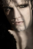 Gothic Model. Extreme close-up portrait of young male goth model Stock Image