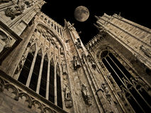 Gothic night. Full moon over Milan gothic cathedral pinnacles stock image