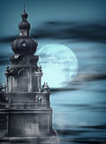 Gothic Night. Background template with gothic structures, fog, and a big, big moon Royalty Free Stock Photos